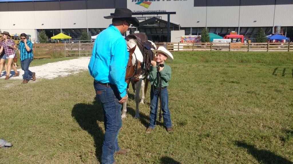 suhls rodeo boy looking up at cowboy